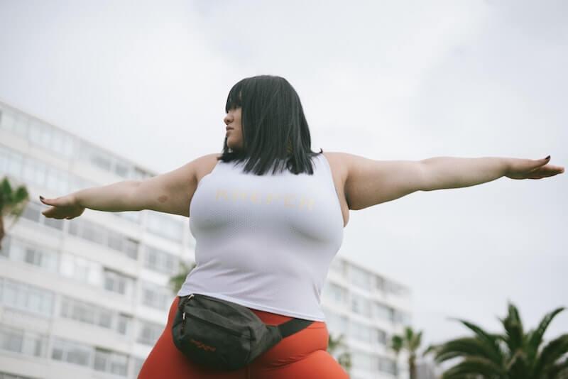 Plus sized woman doing yoga